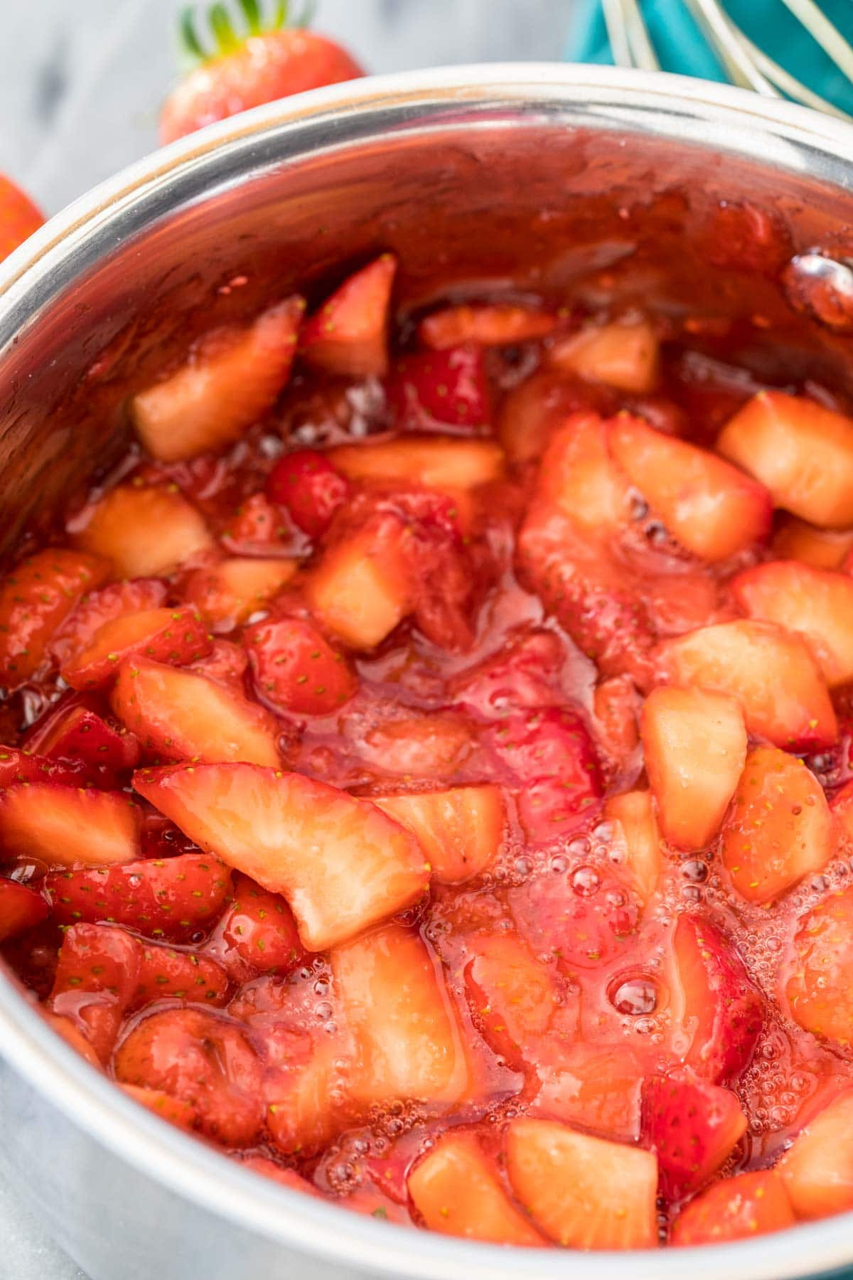 fresh strawberry sauce in saucepan