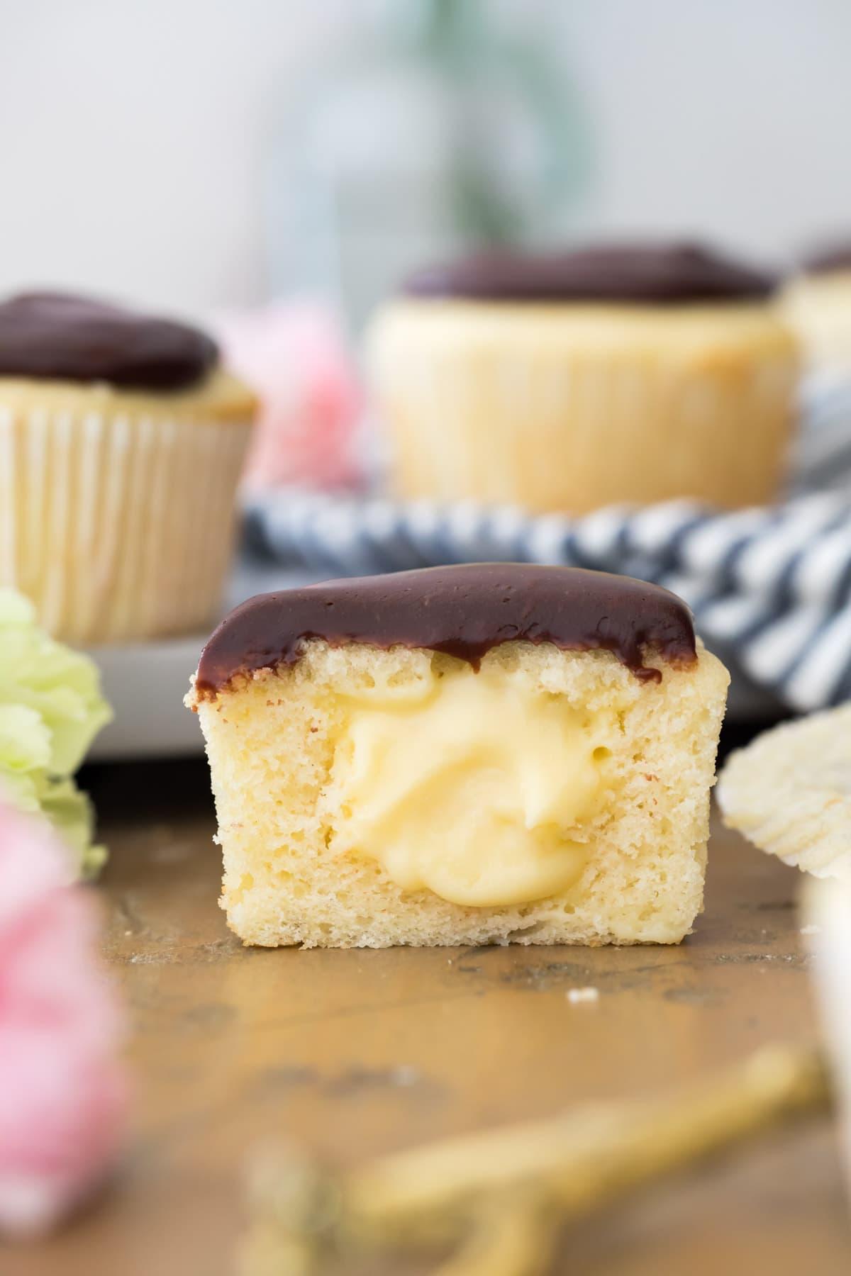 boston cream cupcake cut in half to show center