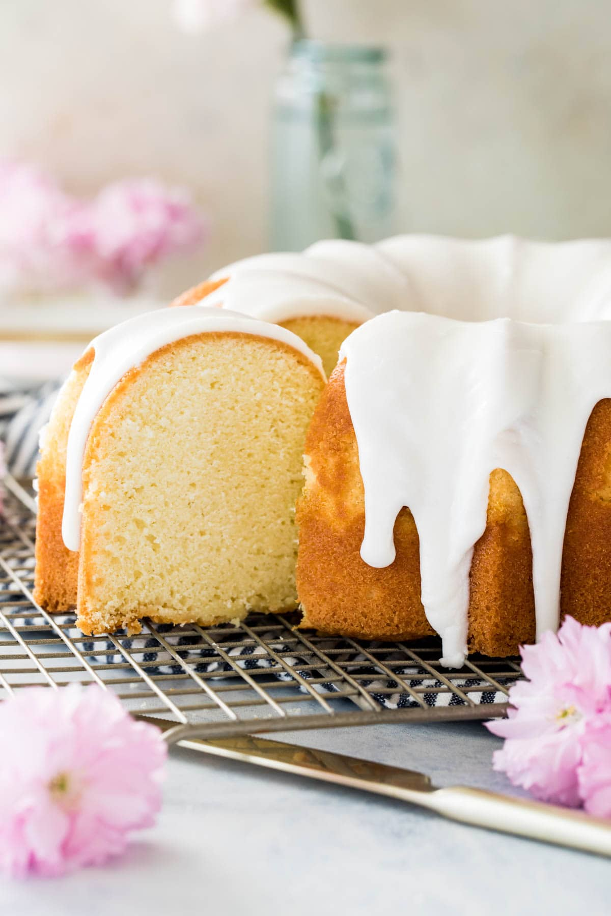 sliced vanilla bundt cake on cooling rack