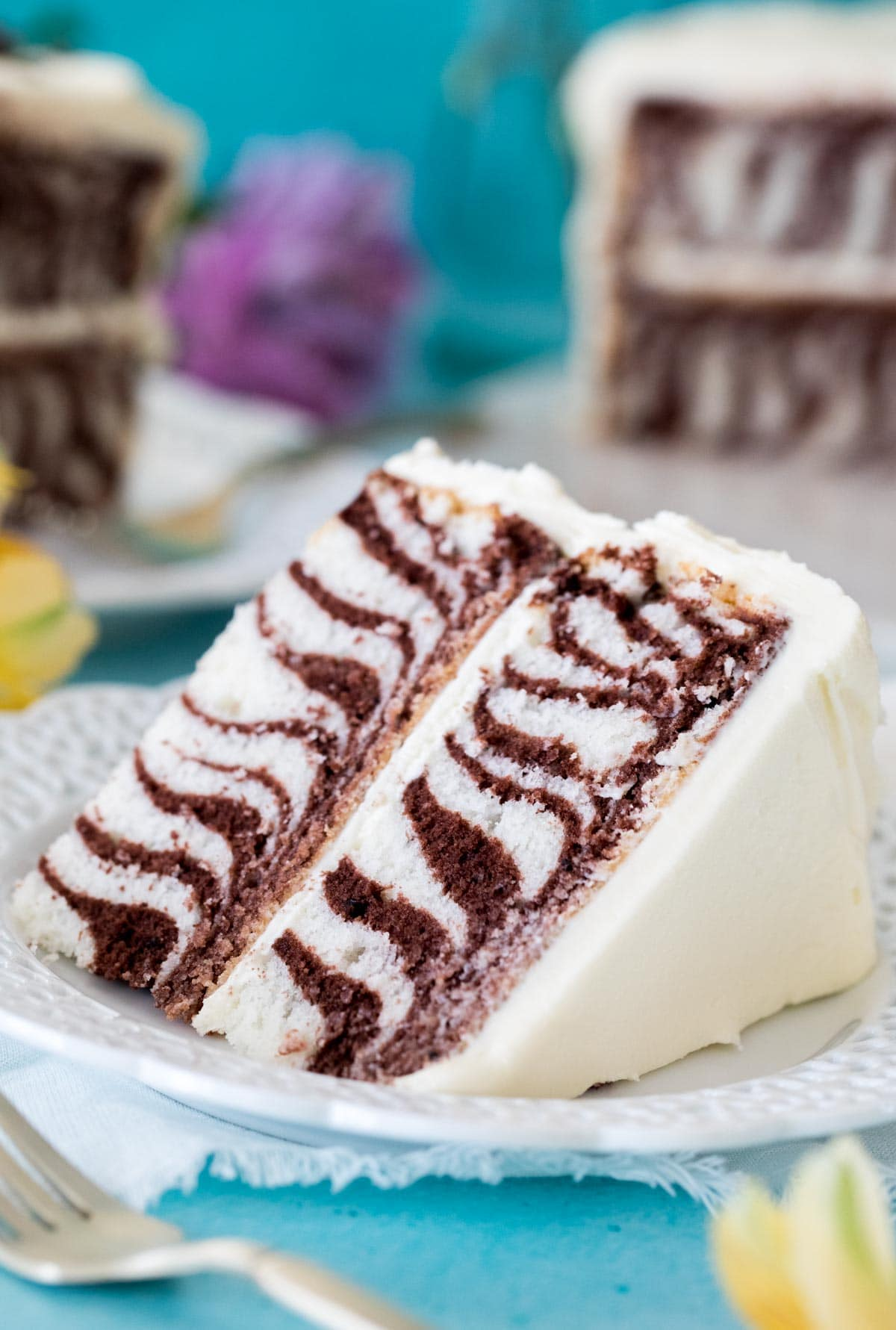 Slice of zebra cake on white plate
