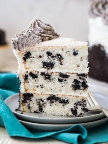 slice of three layer oreo cake on white plate