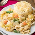 pot pie on white plate with biscuit