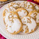 glazed pumpkin cookies on white plate