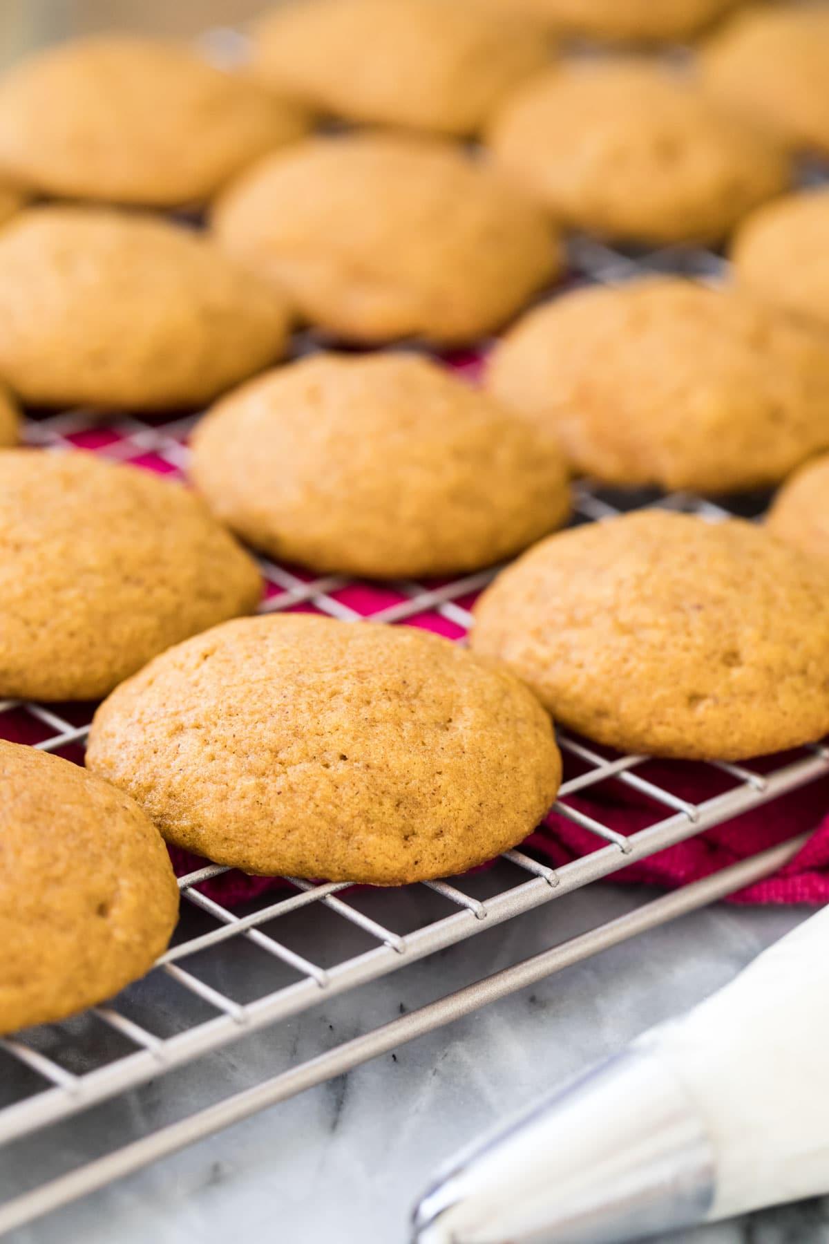 cakey pumpkin cookies on cooling rack