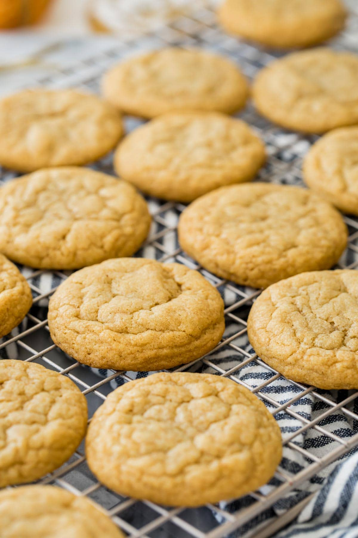 unfrosted pumpkin cookies on cooling rack