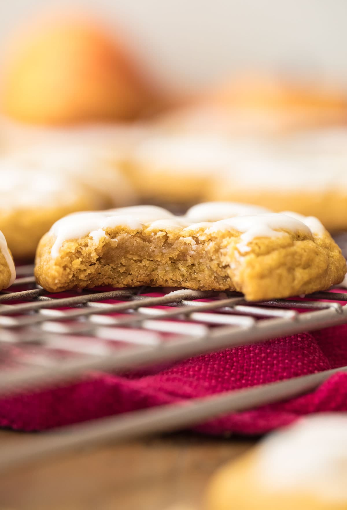 cookie with a bite out of it on cooling rack
