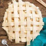 woven pie crust strips over apple pie