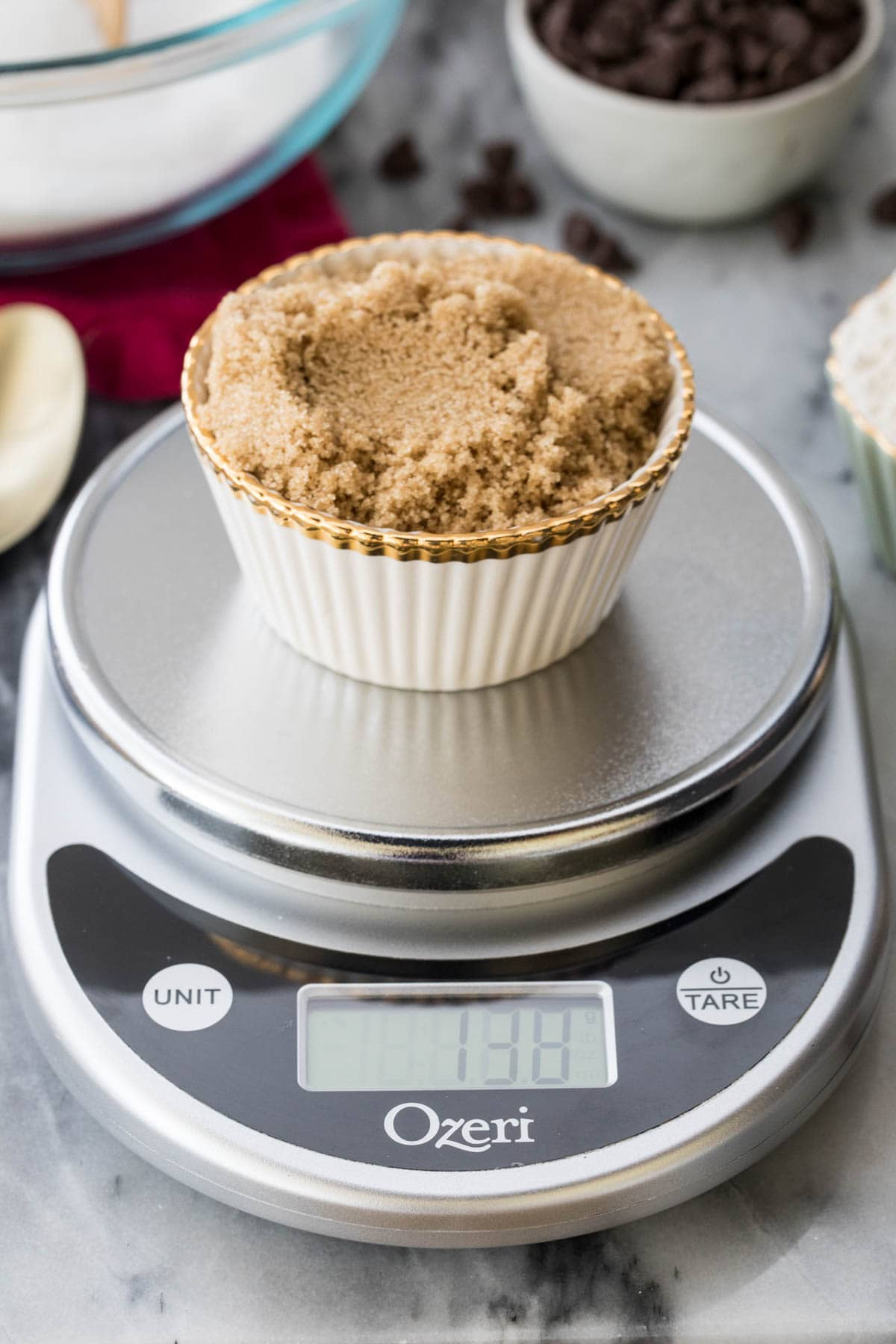 measuring brown sugar on kitchen scale