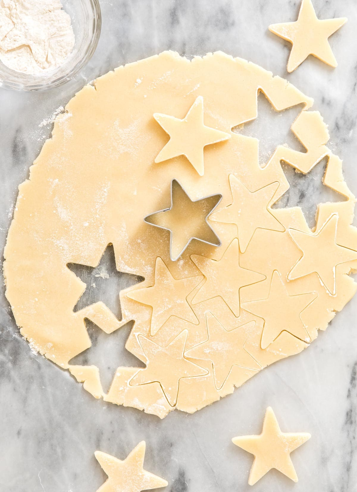 cutting star shapes out of cookie dough
