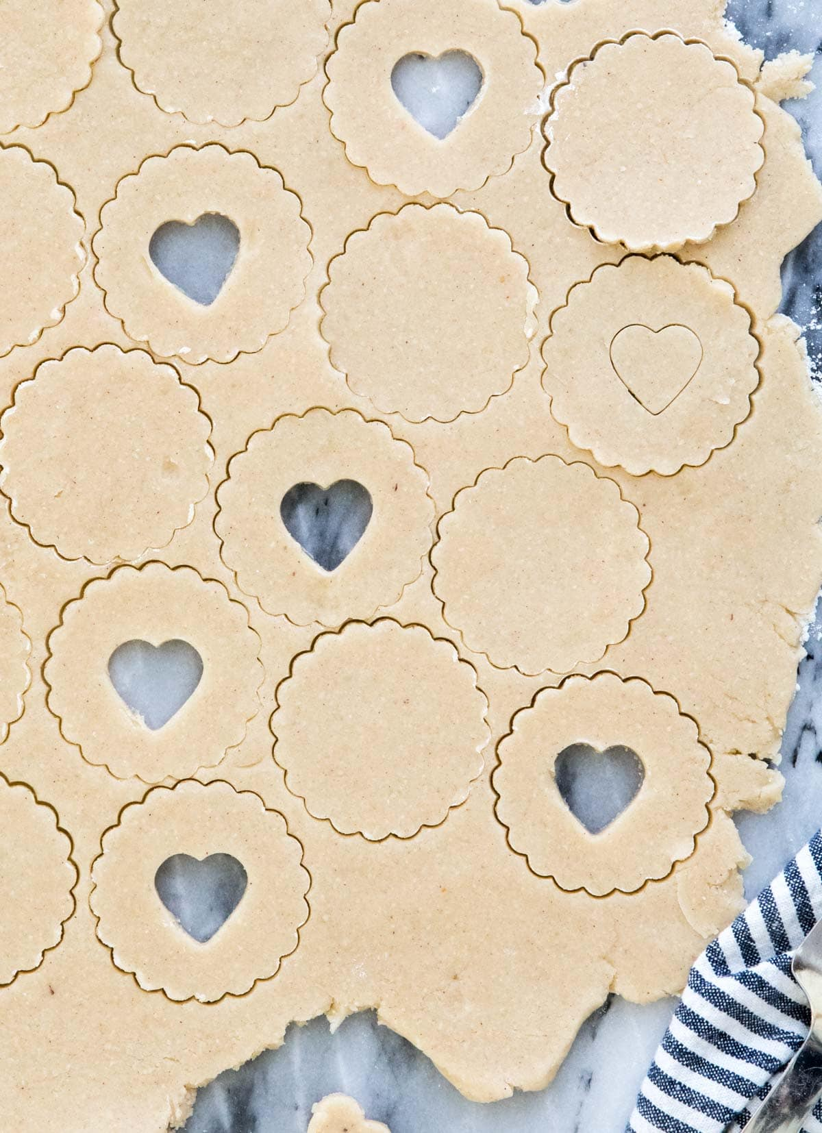 cookie dough with round and heart cutouts