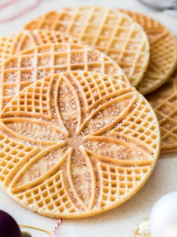 Pizzelle arranged on white board