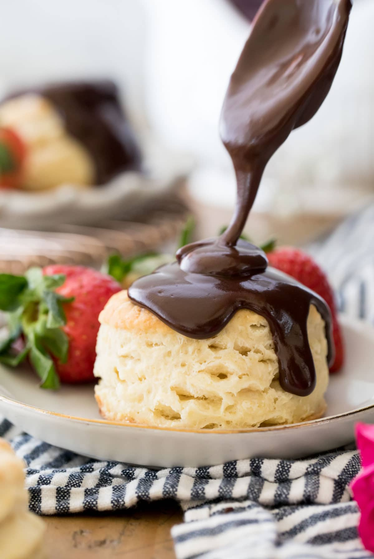 Pouring chocolate gravy over a biscuit