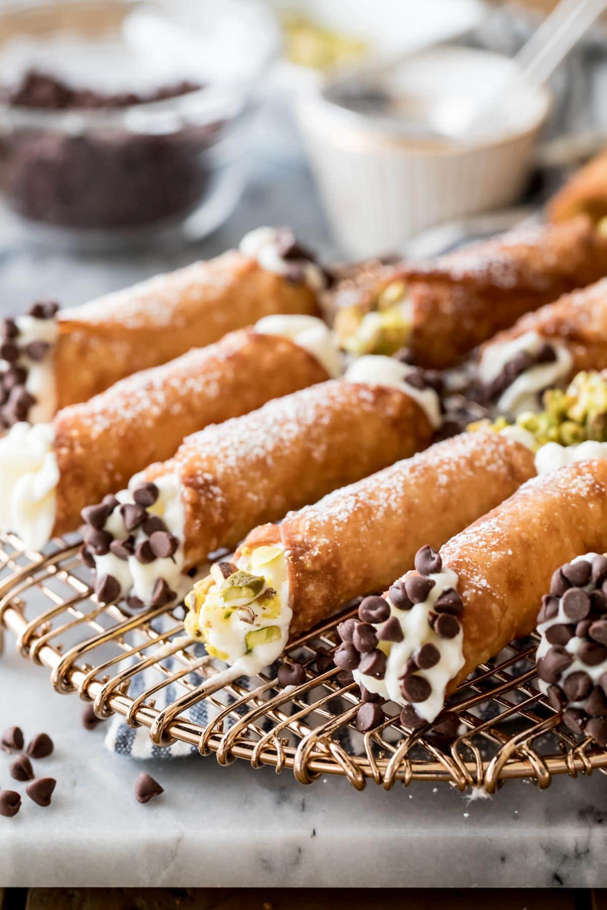 filled cannoli on gold wire rack