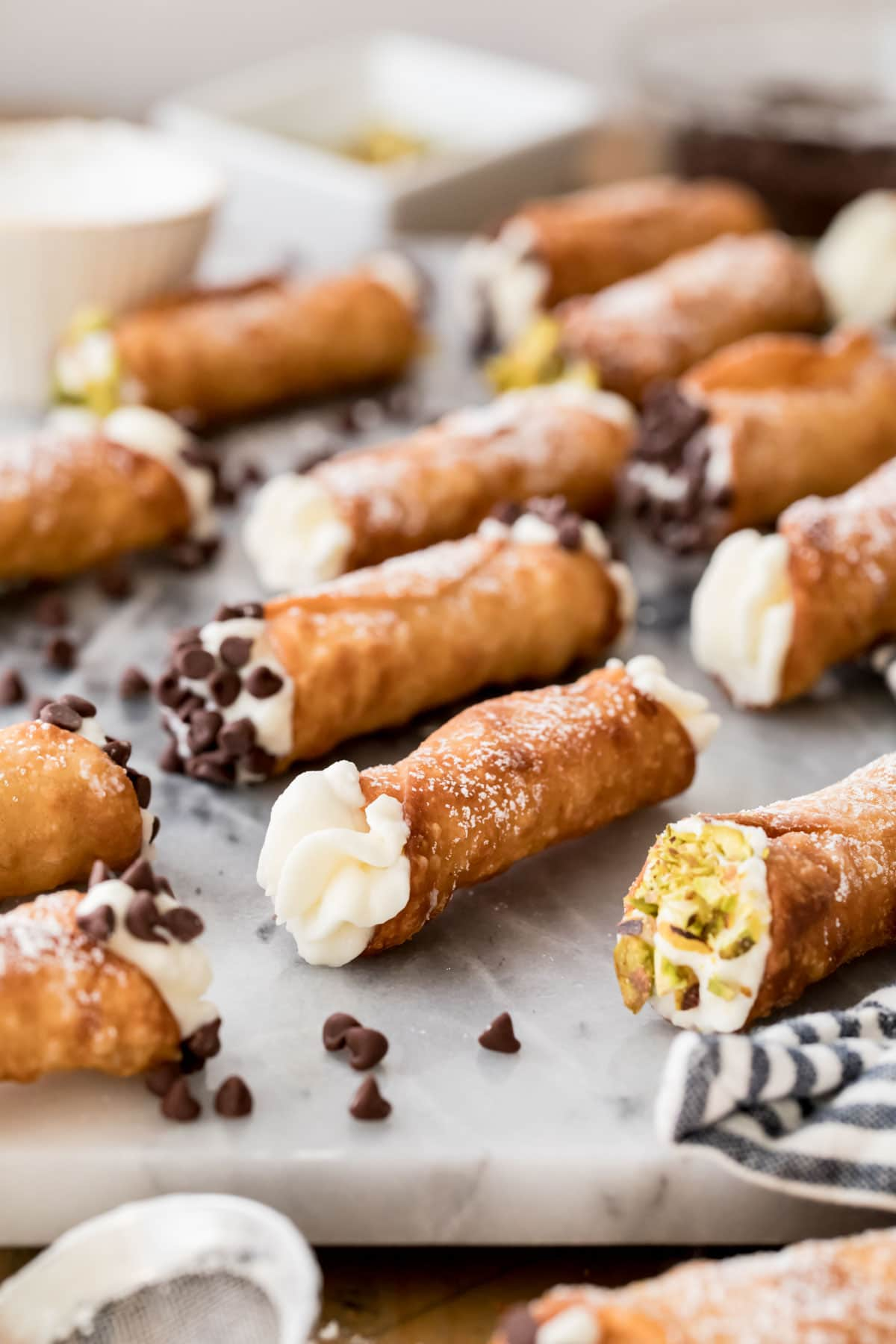 filled cannolis on marble board