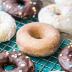 baked donuts with different toppings (chocolate frosting, cinnamon sugar, white frosting)