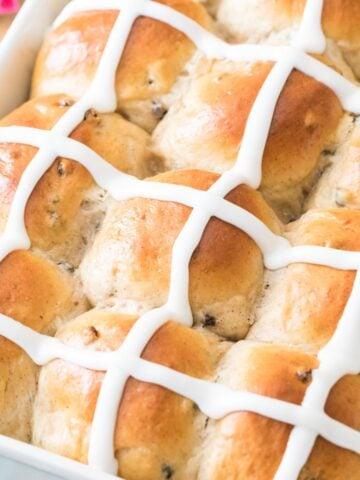 Closeup of iced hot cross buns.