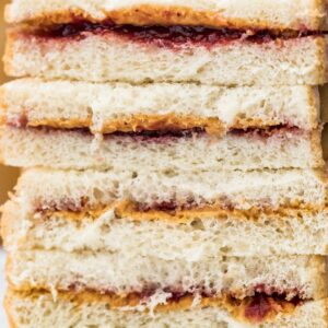 close up of peanut buter and jelly sandwiches cut in half