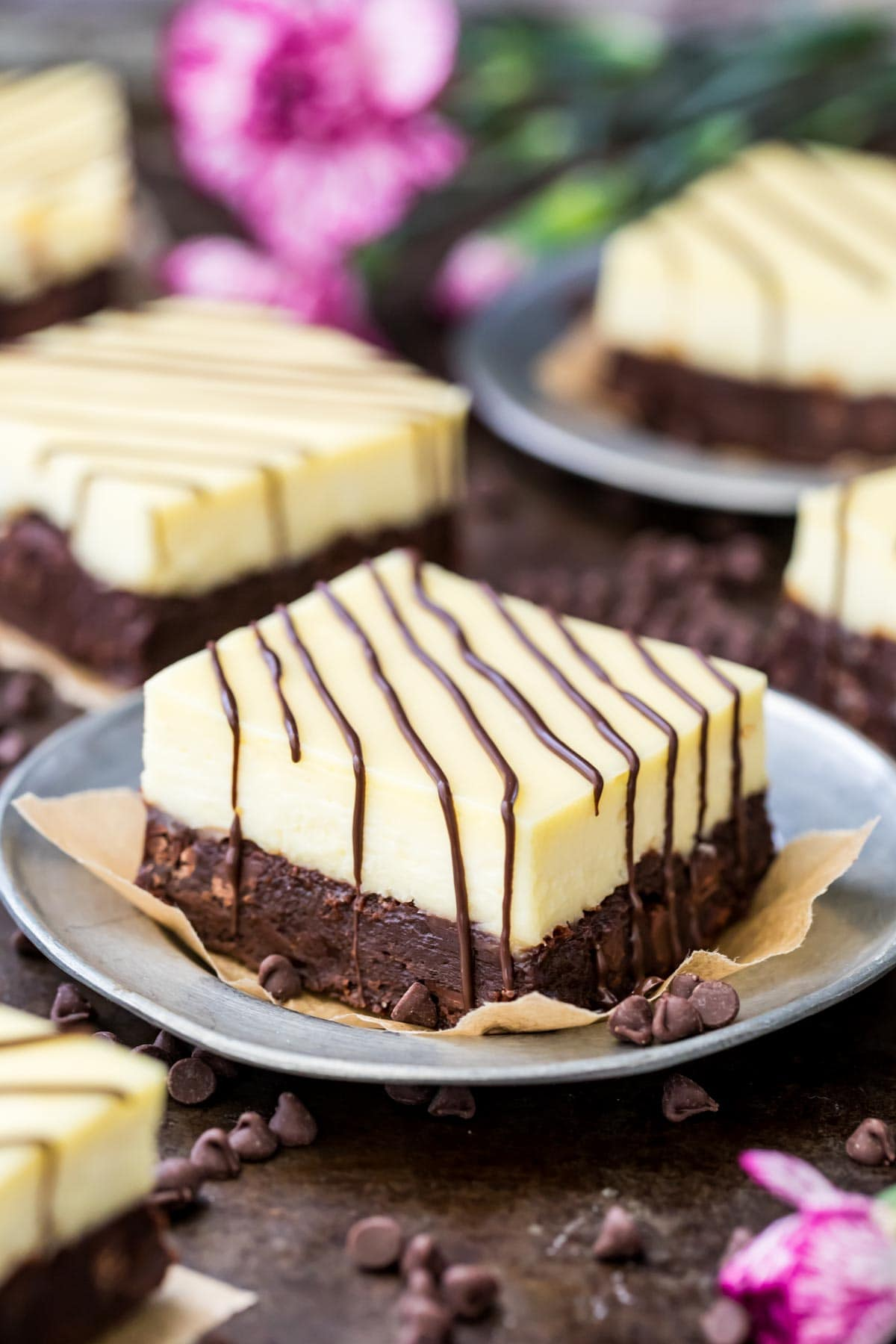 Cheesecake brownie on a gray plate.