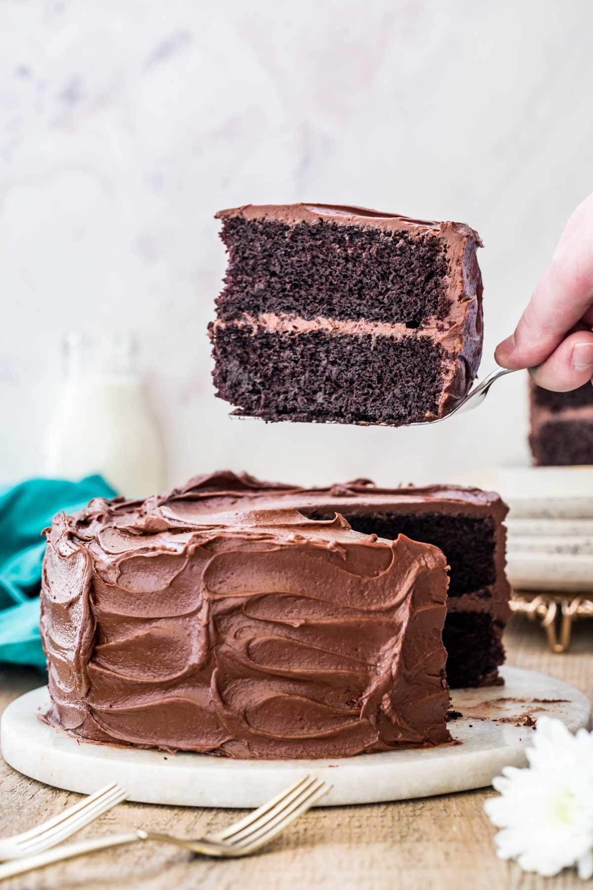 Devil's food cake with a slice being taken out