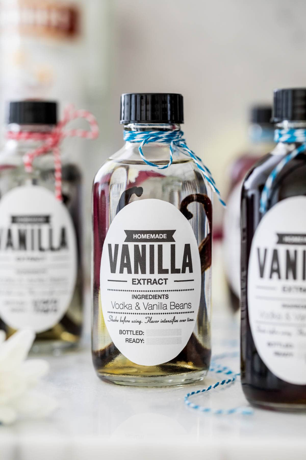 Bottle of extract showing vanilla beans