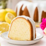 Slice of lemon pound cake on a white plate.