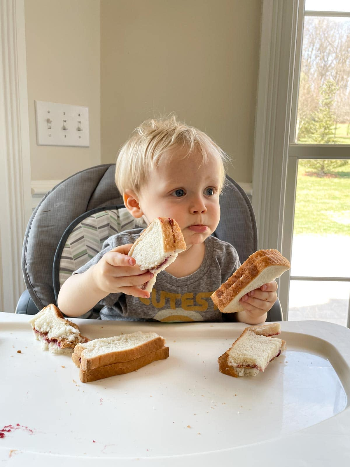 toddler eating peanut butter and jelly