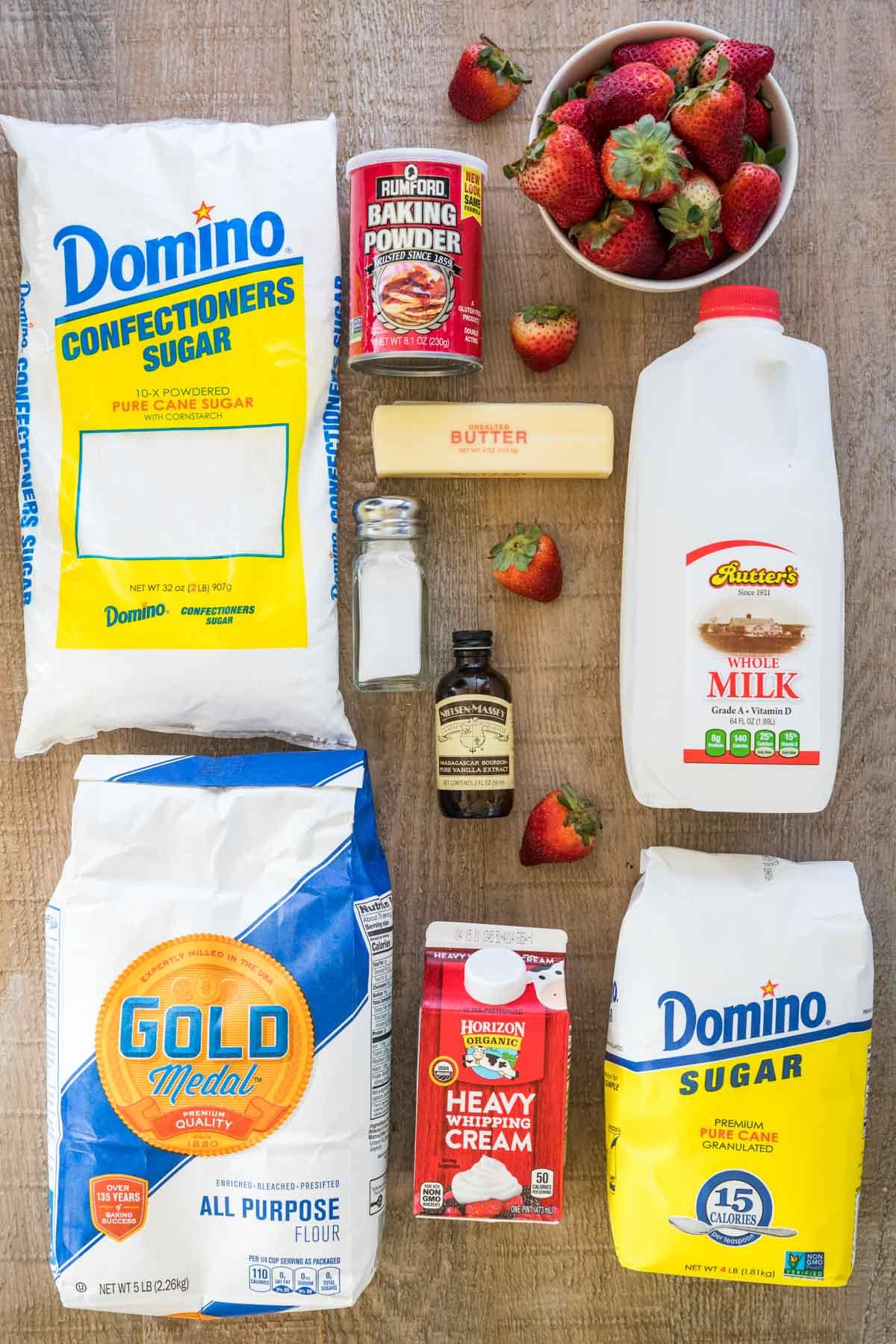 Powdered sugar, flour, heavy cream, sugar, milk, strawberries, baking powder, butter, salt, and vanilla extract.