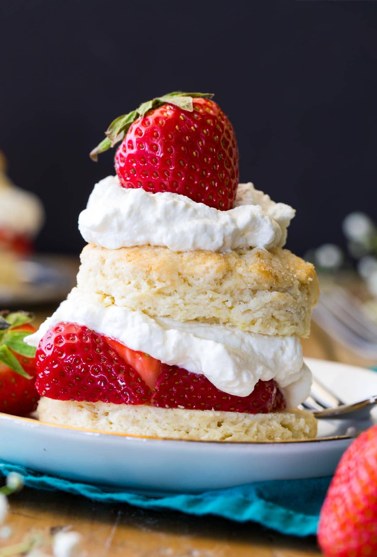 Strawberry shortcake on a white plate.