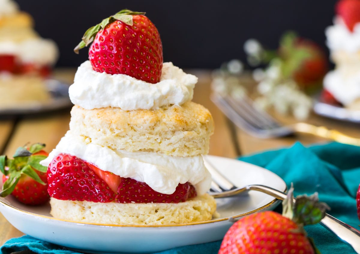 Strawberry shortcake on a white plate with a fork.