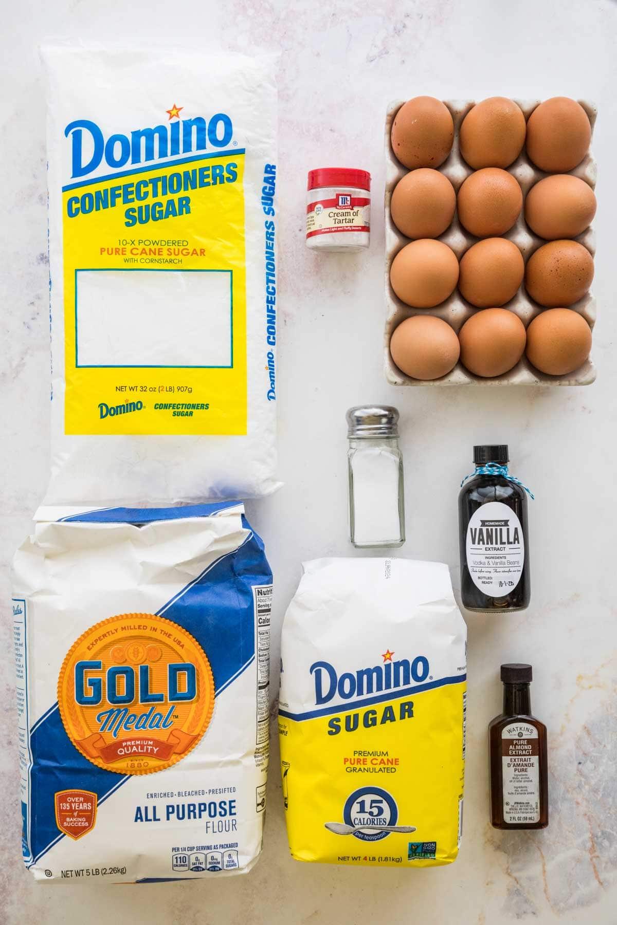 Powdered sugar, cream of tartar, eggs, vanilla extract, almond extract, granulated sugar, salt, and flour