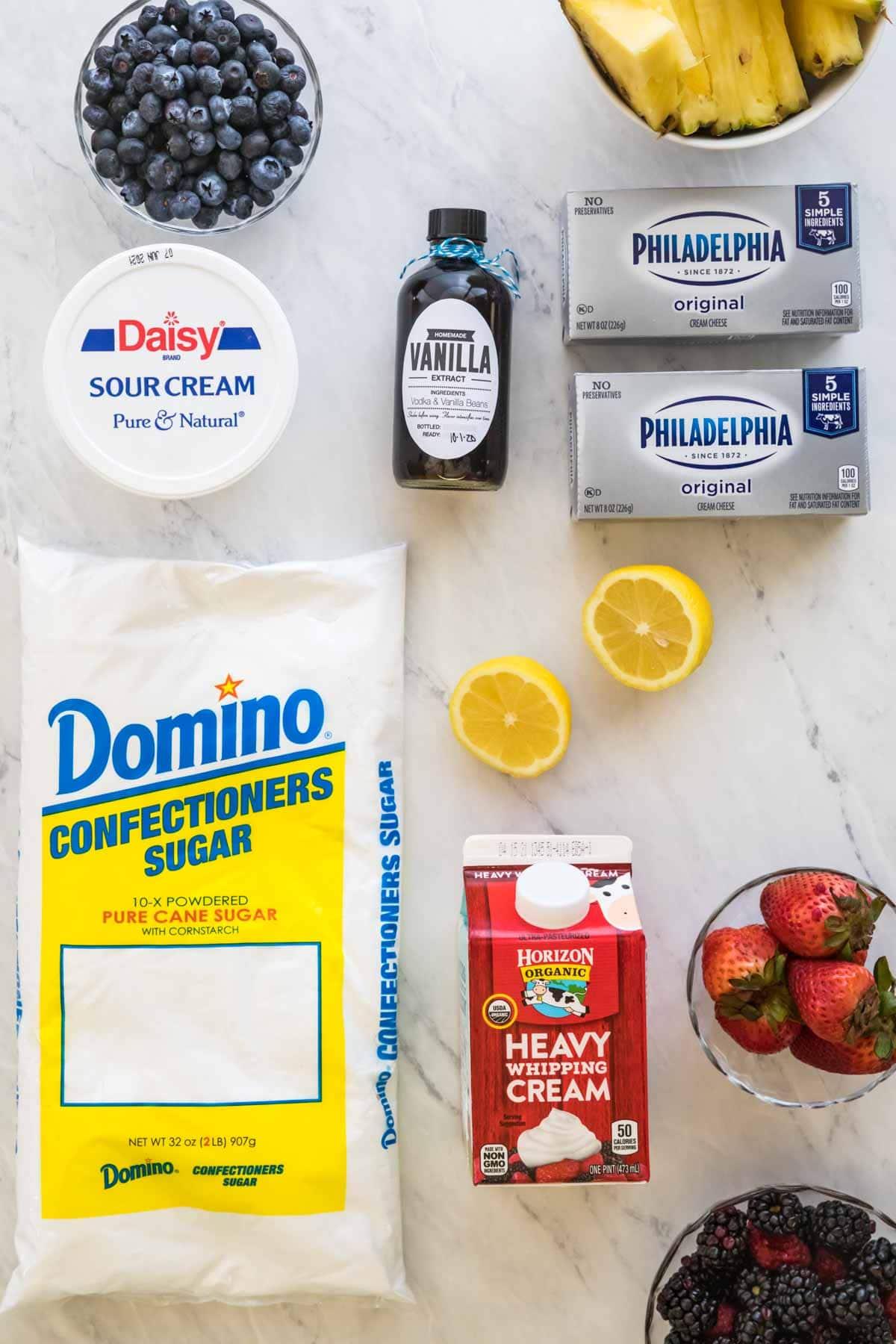 Sour cream, homemade vanilla extract, cream cheese, powdered sugar, and heavy whipping cream.