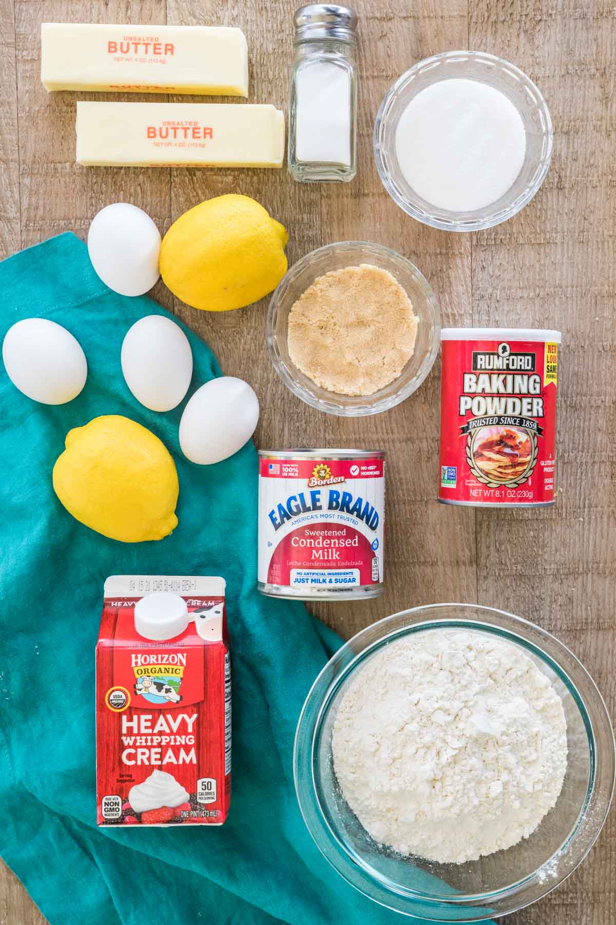 Butter, salt, granulated sugar, eggs, lemons, brown sugar, baking powder, sweetened condensed milk, heavy whipping cream, and flour.