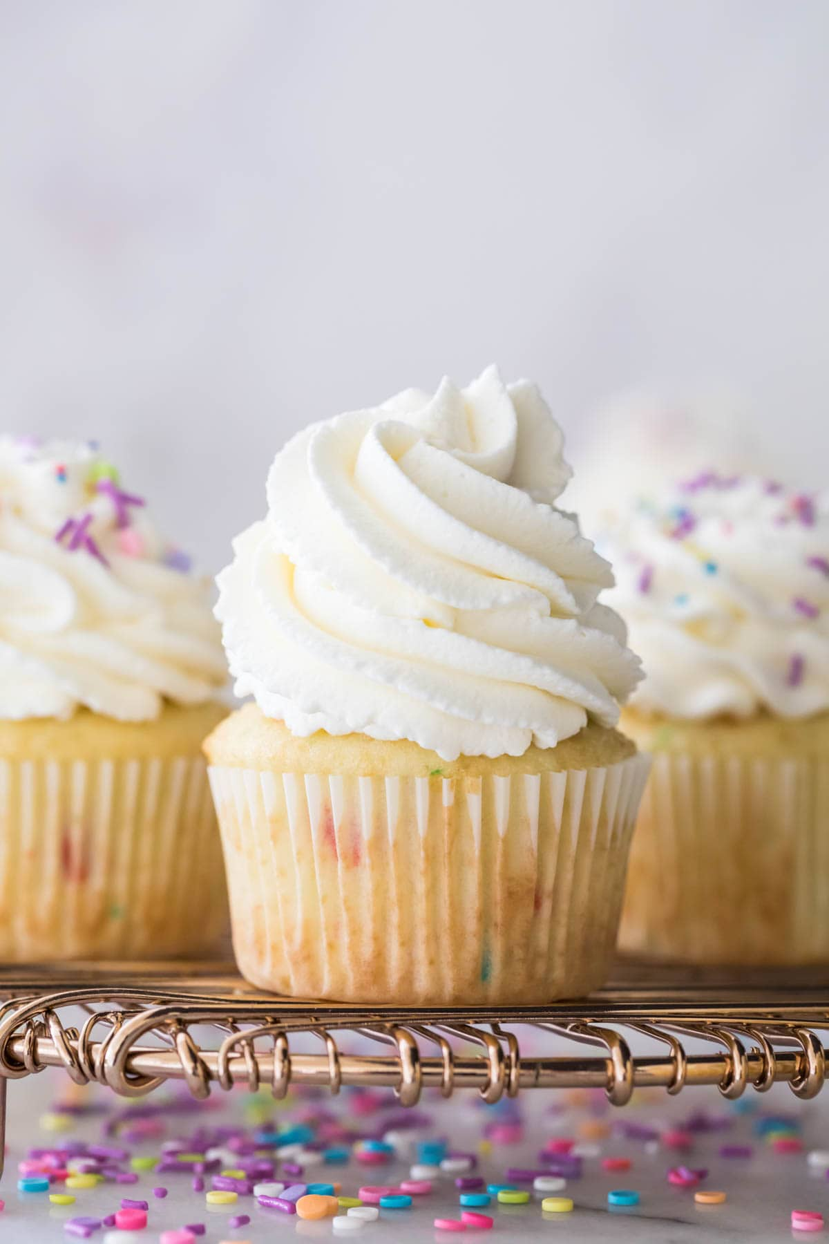 Closeup of cupcake with whipped cream frosting