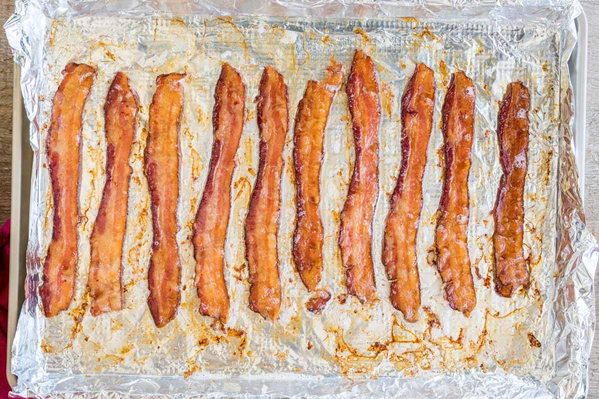 Overhead of bacon in the oven, crisp and golden brown after baking
