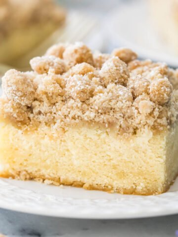 Slice of crumb cake on white plate.