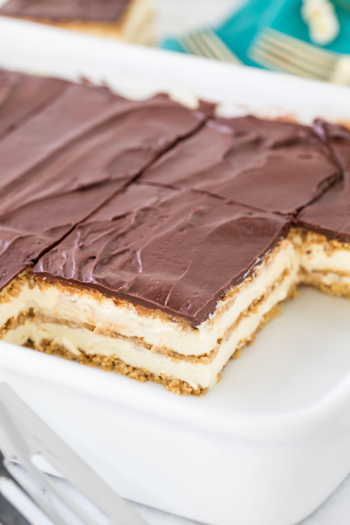 Sliced eclair cake in white rectangular baking dish