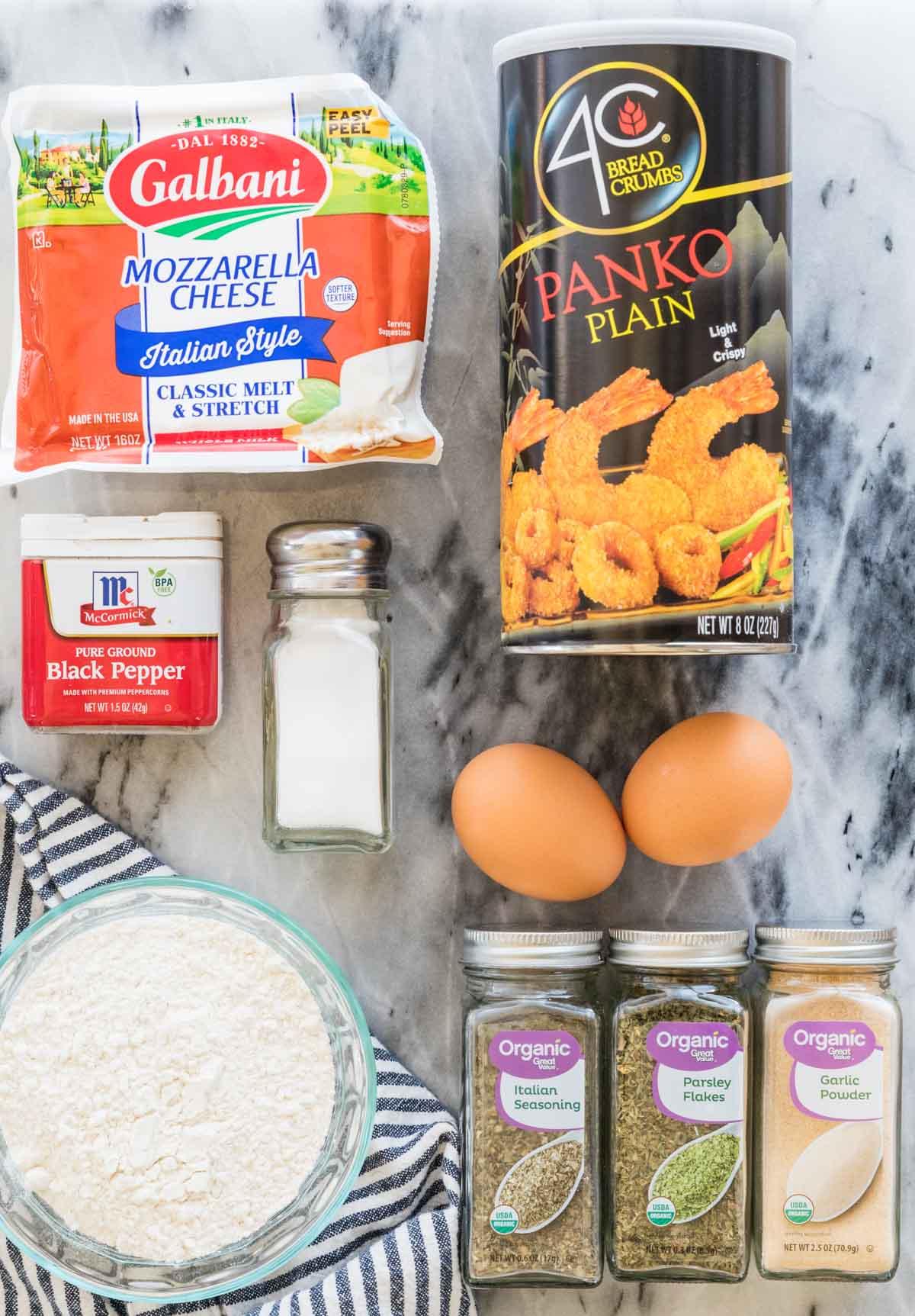 Ingredients for mozzarella sticks on white marble background