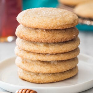 stack of honey cookies on a white plate