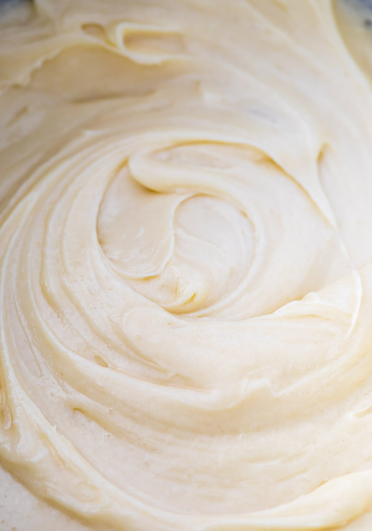 close-up of thick, velvety cream-colored pound cake batter