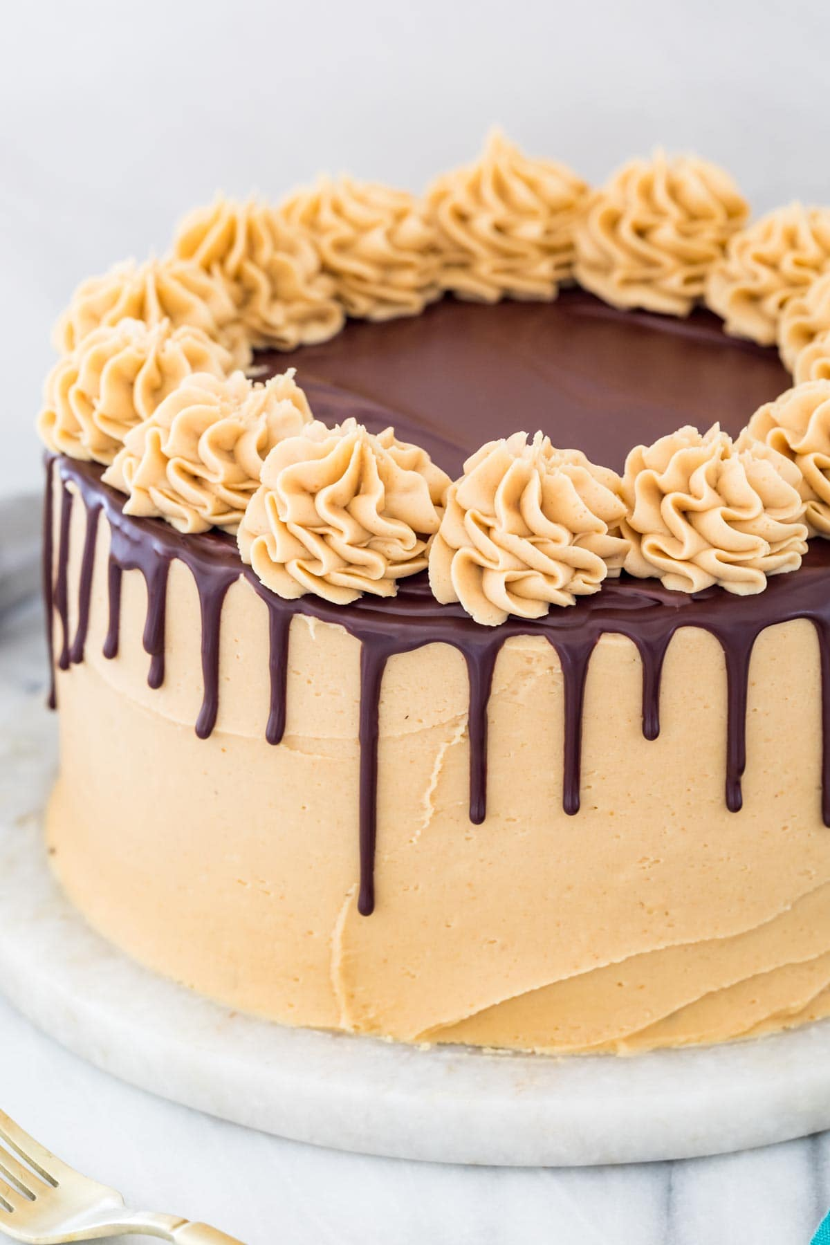 chocolate ganache drip on a peanut butter frosted cake